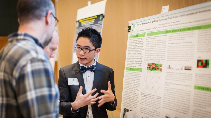 David Chen, a graduate student, discusses his research at a recent poster session