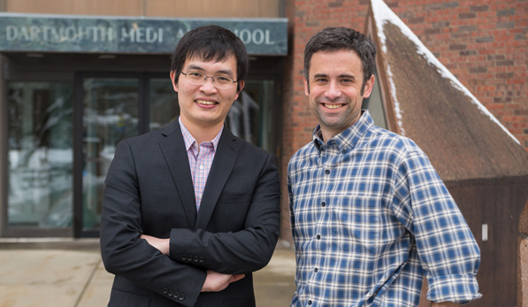 Biochemist Lin Deng, Geisel '15, with his thesis adviser, James Mosely,